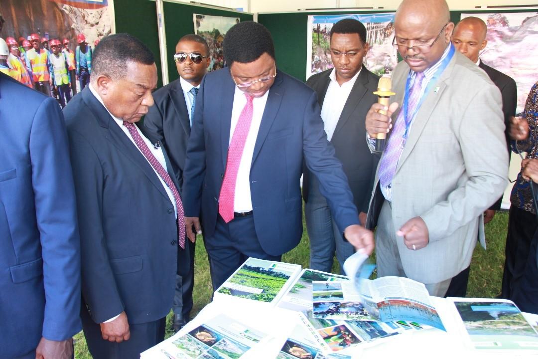 Photos-Eng-Elicad-Nyabeeya-NELSAP-Regional-Coordinator-RC-explains-to-the-PM-third-Left-NELSAP-Work-at-NELSAP-CU-Exhibition-Desk-1